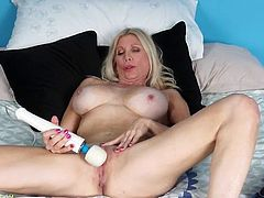Solo milf with incredible fake tits masturbates solo