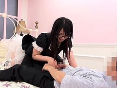 This naughty Japanese babe's favorite game is playing dirty with cock, so watch her unzipping guy's pants and getting busy... She's wearing a black dress and white stockings, while the sexy glasses give her a nerdy appearance. Enjoy the inciting scenes!