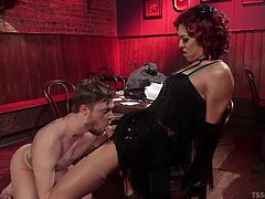 In a dark and smoky bar this amazing looking redhead tranny meets a hunk, that she wants to fuck. When every one else goes home, the couple get naughty. She makes her new sex partner get on his knees and lick her asshole. He can suck her balls and give a good blowjob, too.