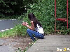 Rather pretty natural brunette gal pulls down her blue jeans and pees
