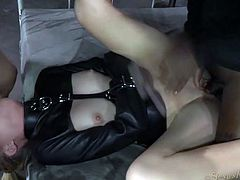 Leather straitjacket on a slutty girl used by two guys