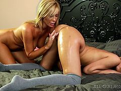 Tasha's big boobs look so tempting! Watch the sensual blonde slut massaging slutty Carmen's lovely buttocks with plenty of oil. Then, dare to see the hot bitch licking her companion's cunt with a burning desire.