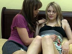 Lesbian girlfriends kiss, tease and scissor on their bed