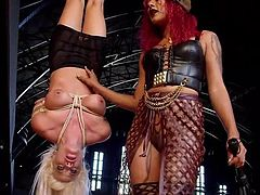 redhead mistress dominating her slave