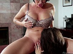 Shay is a caring, compassionate counselor. She wants to know Yhivi's desires and long-term goals. She has one short-term goal, as we see here. She wants to lick pussy and Shay is more than willing to let her fulfill that goal. She goes down on her with delight, licking and fingering the sexy milf.