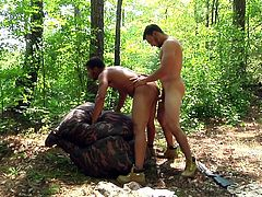 These gay hunks love to experience cocks in their asses and the wonder of the great outdoors. It's even better when they can combine the two together, for a fun experience in nature. One of the hunks is bent over a log and has his tight asshole fucked, and pounded.