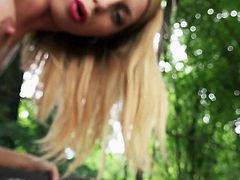 Blond-haired Russian chick Isabella Clark in sexy red dress bares her hot boobs in the park and then gets mouth fucked from your point of view. Watch Isabella Clark give stunning outdoor blowjob!