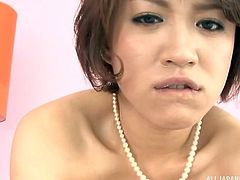 The short-haired milf in the video doesn't wear anything else than a pearl necklace. Click to watch the seductive Japanese lady getting pounded hard from behind. If you like exotic sluts with hairy cunts, enjoy the inciting moments!