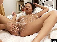 Her man covers her torso and sexy boobs with soap and then sticks his fuck stick inside of her pussy. Since she is soapy they slide around until he is good and ready to cum in her whore mouth.