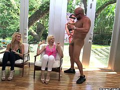 This hunky male stripper is visiting this house, where a sexy bachelorette party is going down. The women are so turned on by his muscles and hard cock. Soon the ladies want to suck his penis so badly. Watch as they take turns sucking. He even lifts up one of the sluts into a standing 69 position.