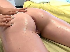 Two horny sluts get to massage a young blonde babe with a back tattoo. They are all lesbians, so, you pretty much know where this is leading to. Have fun while watching this sex massage video