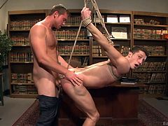 Horny Connor gives his naughty slave the harsh treatment, he deserves... Click to watch the naked bonded stud, sucking his cock. See Drake blindfolded and getting his ass fucked hard from behind. Have fun!