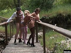 They get it on in a hot outdoor threesome on a park bench in period costumes from the 1920s. They are into pleasuring Clide, played by Paul Chaplin, by sitting on his face and also sitting on his cock to make him cum on their faces.