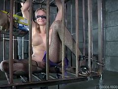 Tattooed slave girl played with in a cage