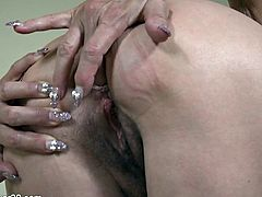 Raven-haired GILF's solo fun