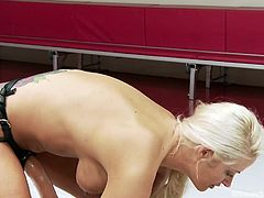 Although the sexy ebony babe seems very agile, it's not enough to compete against the hot blonde lesbian. Click to watch slutty Holly, dominating her rival with her clever movements. The busty milf makes her opponent suck the kinky strap on right in the wrestling arena. She even has her get on her knees