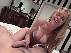 Kayden's attractive boobs make her really desired... The sensual blonde-haired milf has a provocative attitude, which turn on her partner. Click to watch the seductive lady, playing with the guy's dick.