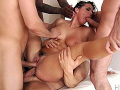 Naughty Keisha is eager to entertain a lusty gang of naked men. See the desiring blonde lady, sucking cock and getting double penetrated. She's got big beautifully shaped tits, which mesmerized these horny guys. Watch her banged hard!