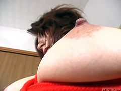 Busty and unfaithful Japanese wife with a natural tan decides to take part in a risque BDSM shoot that sees her preternaturally large breasts toyed with featuring English subtitled internal monologue