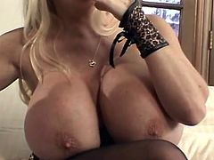 Unbelievably huge breasted blonde bitch sucks and jerks off dick with joy