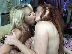 Red-headed lesbian with huge tits getting her hairy pussy fingered