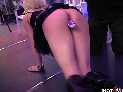 Nora Barcelona, a horny blonde model, struts her stuff through a sex convention and uses the Hotgvibe and gspot vibrator to fuck her self in front of a huge crowd until the sex toy gives her an enormous squirting orgasm.