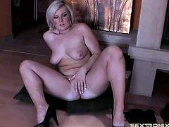 Curvy girl with a French manicure rubs her pussy