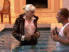 Fur jacket babe gets in the pool and sucks on his hard cock