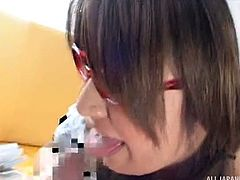 This Japanese nerd gives amazing blowjobs and she looks really sexy doing it, in her glasses and maid cosplay uniform. The hottie deepthroats his cock and licks his balls. She wants to see him orgasm hard.
