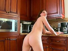 Sara Stone is a brunette that is giving a blow job. She is a chick with large natural tits. Her mouth is filled up with cum and she is really liking the taste of it.