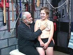 Young and innocent brunette's first bondage experiment