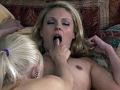 A cute blonde lesbian couple finishes their evening with hot sex