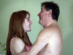 Any guy would be lucky to snag a redhead, but this guy is really lucky! He gets not only a ginger, but one just barely legal at that. She has no problem sucking and fucking him, especially since he's loaded. They kiss and his mouth going right to her tiny tits, to suck on them.