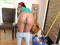 sexy girl Gina Valentina with perfect ass takes off her jeans while cleaning the room in front of the camera. She puts her awesome booty on show with her thong panties on.