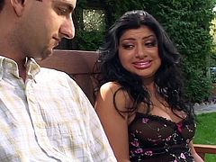 This guy has never had anything other than white girls his whole life. He is in for a treat, when he decides to go Indian and gets Sativa. The raven-haired seductress takes care of her man outside on the bench. She shows off her tits and sucks his cock, smiling the whole time she does it. What a day!