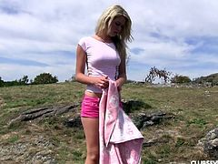 Blonde on a solo picnic fingers her cunt in the grass