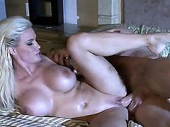 Diamond Foxxx is a blonde with huge tits and a nice ass. She is in the bedroom with a guy and she is jumping on a dick after she has gotten it hard with her mouth.