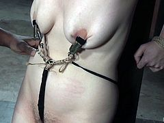 Jessica gets tortured by an ebony horny dominant guy, who tied her up. Watch her wearing kinky clamps on her yummy nipples, as the man fingers her cunt. Then, this naked babe is encouraged to suck a black dildo. Using sex toys, such as a vibrator, heats up the atmosphere!
