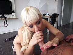 Small tit blonde lass handling a massive dick in this video