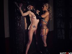Ginger Hell, a hot latex clad MILF, dominates Valeri Bianco, a shy young girl restrained to an armoire. Ginger Hell uses the Hotgvibe cock ring to ravage Valeri Biancos shaved and engorged pussy and forces her to have a screaming, squirting orgasm.