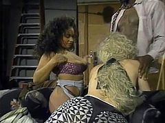 If you like Indian sluts, interracial action and retro porn, this scene is right up your alley. These two sluts, one Indian and the other white, take turns pleasuring this studly black guy. He bends the blonde over and gives it to her deep and hard, pounding her pussy unmercifully, as Persia watches.