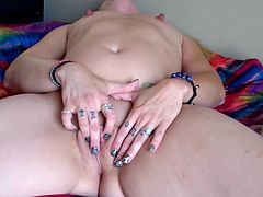 Dirty thick girl with flat chest masturbates in the bed