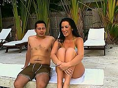Jayden Jaymes is a milf porn star with huge tits. She is sucking a dick by the pool. The babe is really into the guy and she does her best to satisfy him.