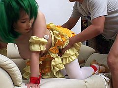 She is dressed up in her favorite cosplay outfit. She is a slut, just like the Anime character she is dressed up as. The slut takes it from behind, while getting cock in her mouth. The three men have their way with their fuck toy.