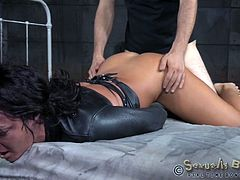 London is tied up, restrained in a sexy leather top. It's almost like a straitjacket, the way her arms are bound. She's getting no mercy at all from these two guys, brutally pounding her mouth and her pussy at the same time. She gets flipped over and banged some more, screaming the whole time.