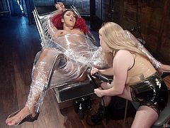 Aiden knows that Daisy is fresh, but she secures her to the table with shrink wrap anyway, just in case. Daisy squirms and screams, as Aiden shoves electric dildos and vibrators in her dripping wet pussy, but she can't get away from it. She must endure all the pleasurable torture until it's all done.