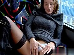 Mature hottie plays with her pussy in a bus