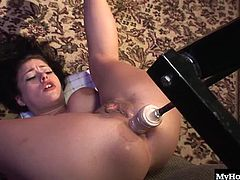 First she strips out of her white corset and sucks on the big dildo that is going to enter her pussy. Then she allows the fuck machine to pound her pussy and then her ass.