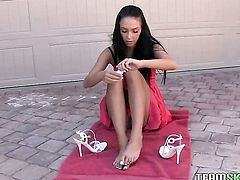 Teen brunette Stephanie Cane massages her feet