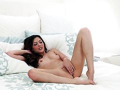 Ultra hot woman Cassie Laine with small boobs and smooth muff fucks herself to orgasm in solo action